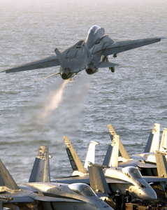An F-14b Tomcat Assigned To The Red Rippers Of Fighter Squadron One One (vf-11) Launches Off The Flight Deck Of Uss George Washington (cvn 73) During Evening Flight Operations. Image