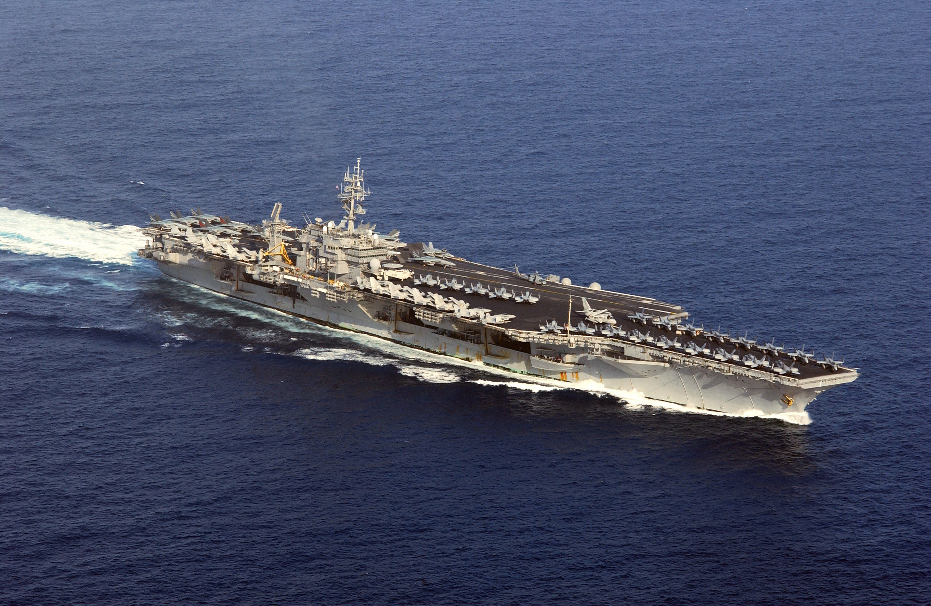 an aerial view of uss kitty hawk  cv 63  en route to the 5th fleet area of operations