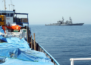 U.s. Navy Destroyer Inspects Merchant Vessel In The Arabian Gulf. Image