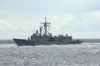 The Guided Missile Frigate Uss Rodney M. Davis (ffg 60) Steams Alongside Aircraft Carrier Uss Nimitz (cvn 68). Image