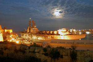 The Amphibious Assault Ship Uss Wasp (lhd 1) Is Well Lit While Moored Pier-side In Valletta, Malta During A Four-day Port Visit. Image
