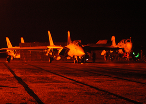 An F-14 Tomcat And An Ea-6b Prowler Prepare To Launch From One Of Four Steam Driven Catapults On The Flight Deck Of Uss Theodore Roosevelt (cvn 71) Image