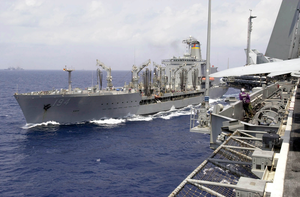 The Military Sealift Command (msc) Ship Usns John Ericsson (t-ao 194) Pulls Along Side Uss Nimitz Image
