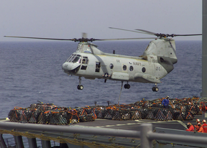 A Ch-46 Helicopter Transports Supplies From The Military Sealift Command Auxiliary Oiler Usns Guadalupe (t-ao 200 ) To The Amphibious Command Ship Uss Mount Whitney (lcc 20). Image
