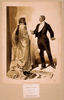 [man In Tuxedo Questioning Woman In Cloak & Gloves] Image