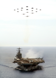 Aircraft Assigned To Carrier Air Wing Eight (cvw-8) Fly In Diamond Formation Over The Nuclear Powered Aircraft Carrier Uss Theodore Roosevelt (cvn 71). Image