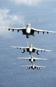 During Flight Operations F/a-18f Super Hornets Fly Over The Western Pacific Ocean In A Tight Formation. Image