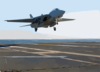 An F-14d  Tomcat  From The  Black Lions  Of Fighter Squadron Two One Three (vf-213) Lands On The Ship S Flight Deck After A Training Mission. Clip Art