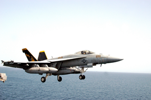 An F/a-18e Super Hornet Configured In The Mission Tanker Role Clears The Flight Deck During Combat Flight Operations Aboard Uss Abraham Lincoln (cvn 72) Image