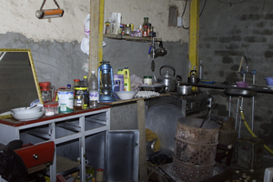 A Modest Array Of Items Sits Inside The Makeshift Kitchen Where Saddam Hussein Probably Ate His Last Meal Before His Capture. Image
