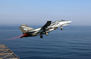 An F-14a Tomcat Assigned To The Black Knights Of Fighter Squadron One Five Four (vf-154) Makes A Catapult Launch Image