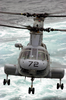 A Ch-46 Sea Knight Transfers Supplies From Fast Combat Support Ship Uss Bridge (aoe 10) To Uss Nimitz (cvn 68) During A Connected Replenishment (conrep) Image