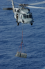 An Mh-60s Knighthawk  Transports Ammunition From The Uss Harry S.truman (cvn 75) To The Military Sealift Command Ammunition Ship Usns Mount Baker (t-ae 34) During An Ammo Off-load Image