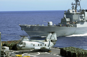 A Ch-46 Sea Knight Transfers Supplies From The Fast Combat Support Ship Uss Bridge Image