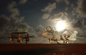 An E-2c  Hawkeye  From The  Tigertails  Of Airborne Early Warning Squadron One Two Five (vaw-125) And An Ea-6b  Prowler  From The  Scorpions  Of The Tactical Electronic Warfare Squadron One Three Two (vaq-132) Stand Ready On The Flight Deck At Night. Image