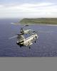 Two Uh-46  Sea Knights  And One Uh-60  Black Hawk  Fly Toward Guam As A Part Of A Six-helicopter Formation During Flight Training. Image