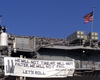 The Amphibious Assault Ship Displays A Banner From Her Stern Quoting President Bush:  We Will Not Tire, We Will Not Falter, We Will Not Fail Image