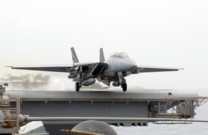 An F-14a Tomcat Fighter Aircraft Launches From One Of Four Steam Powered Catapults Aboard Uss Kitty Hawk (cv 63) 2 Image