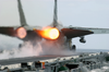 After Burners On An F-14 Tomcat Fire As The Aircraft Makes A Cataputl Launch. Image