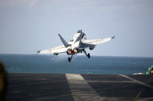 Hornet Launches From The Flight Deck On A Christmas Morning Mission Image