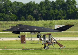 A Wright B Flyer Replica Taxis Past A United States Air Force F-117a Stealth Fighter During The U.s. Air And Trade Show. Image