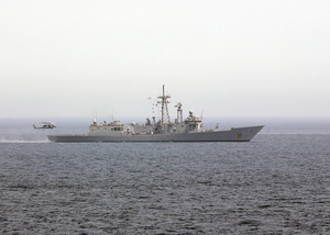 He Guided Missile Frigate Uss Thach (ffg 43) Steams Along As A Helicopter Lands On It Image