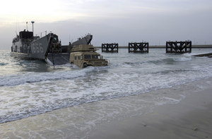 A High Mobility Multi-purpose Wheeled Vehicle (hmmwv) Roles Off Of A Landing Craft Utility (lcu) From The Uss Tarawa (lha 1) Amphibious Ready Group (arg) Image