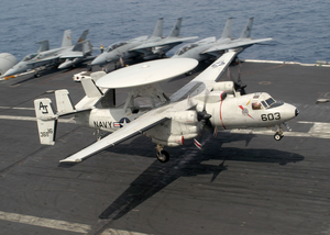 A E-2c Hawkeye Assigned To The  Bear Aces  Of Carrier Airborne Early Warning Squadron One Twenty Four (vaw-124) Lands On The Flight Deck Of Uss Theodore Roosevelt (cvn 71). Image