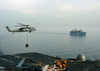 An Mh-60s Knighthawk Assigned To The  Chargers  Of Helicopter Combat Support Squadron Six (hc-6), Detachment 4, Delivers Supplies To Uss George Washington (cvn 73). Image
