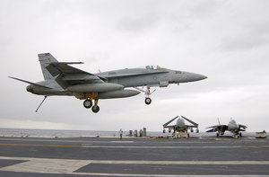 Hornet With Its Tailhook Down, Attempts A Controlled Landing On The Ship S Flight Deck Image