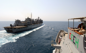 The Guided Missile Cruiser Uss Chosin (cg 65) Prepares To Come Alongside The Fast Combat Support Ship Uss Bridge (aoe 10) In Preparation Of An Underway Replenishment Image
