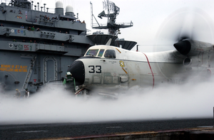 A C-2a Greyhound Assigned To The Providers Of Fleet Logistics Support Squadron Thirty (vrc-30/det 4) Is The First Plane To Launch During The Fly Off Of Carrier Air Wing Nine (cvw-9) Image