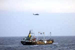 Sh-60 Helicopter Observes Merchant During Mio Image