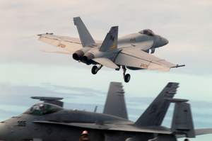 An F/a-18e Super Hornet, Assigned To The Eagles Of Strike Fighter Squadron One One Five (vfa-115), Takes Off From The Flight Deck Of Uss John C. Stennis (cvn 74) Image