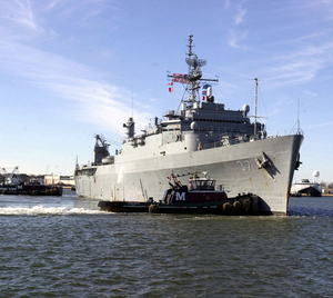 Uss Portland (lsd 37) Sails Through The Harbor As It Heads Out To Sea Image