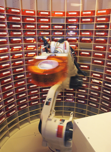 The Autoscript Iii, Prescription Filling Robot, Picks Up A Bin Of Medication At The National Naval Medical Center In Bethesda, Md. Image