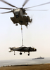 A Ch-53 Sea Stallion Drops A Retired Av-8 Harrier On The Flight Deck Aboard Uss Saipan (lha 2) Image