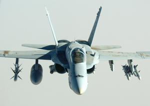 A U.s. Navy F/a-18 Hornet Proceeds On Its Mission In Support Of Operation Iraqi Freedom. Image