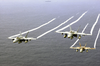 F/a-18a Hornets Fly Over The Western Pacific Ocean During Flight Operations. Image