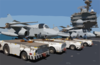 Tow Tractors Are Positioned On The Starboard Side Of The Flight Deck In Preparation For Aircraft Movement After The Conclusion Of Daily Flight Operations Aboard The Aircraft Carrier Uss Kitty Hawk (cv 63) Clip Art