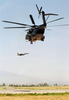 An Air Force F-15e Strike Eagle Takes Off As An Mh-53e Sea Dragon Helicopter Hovers Near The Active Runway At Naval Air Station (nas) Sigonella. Image