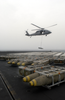 A Sh-60f Knighthawk Helicopter Delivers Ammunition During An Ammo Onload Aboard Uss Constellation (cv 64). Image