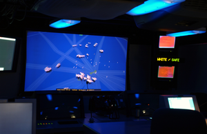 Aboard Uss Blue Ridge (lcc-19), Aircraft And Ships Are Tracked On Screen Utilizing The Area Air Defense Coordinator Image