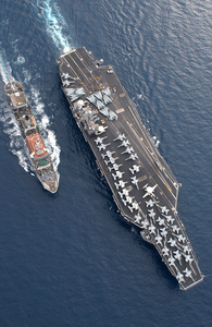 The Military Sealift Command (msc) Combat Stores Ship Usns Spica (t-afs 9) Steams Alongside The Nuclear Powered Aircraft Carrier Uss Harry S. Truman (cvn 75). Image