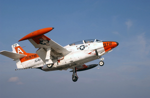 A T-2c Buckeye Flies Over The Flight Deck. Image