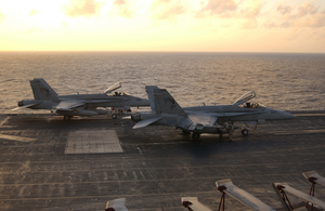 Two F/a-18c  Hornets  Assigned To The  Golden Dragons  Of Strike Fighter Squadron One Nine Two (vfa-192) Sit Prepared For A Quick Launch If Necessary Image