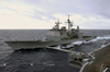Uss Cowpens (cg 63) Pulls Alongside Uss Kitty Hawk (cv 63) For Replenishment-at-sea Evolutions Image