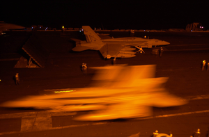 An F/a-18f Super Hornet  Prepares To Take Off From One Of Four Steam-powered Catapults During Night Flight Operations On The Flight Deck Aboard Uss Nimitz (cvn 68). Image