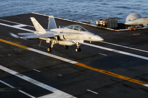 An F/a 18 Hornet Lands On The Flight Deck Image