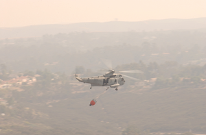 A Sea King Helicopter (uh-3h) Assigned To The Golden Gators Of Reserve Helicopter Combat Support Squadron Eighty Five (hc-85) Assists In Fire Fighting Efforts Throughout The Scripps Ranch Area Of San Diego Image